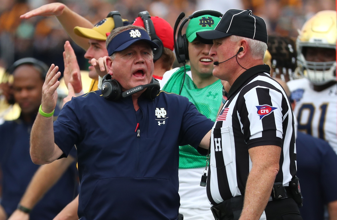 Dec 28, 2019; Orlando, Florida, USA; Notre Dame Fighting Irish head coach Brian Kelly reacts to the referee against the Iowa State Cyclones during the second half at Camping World Stadium. Mandatory Credit: Kim Klement-USA TODAY Sports