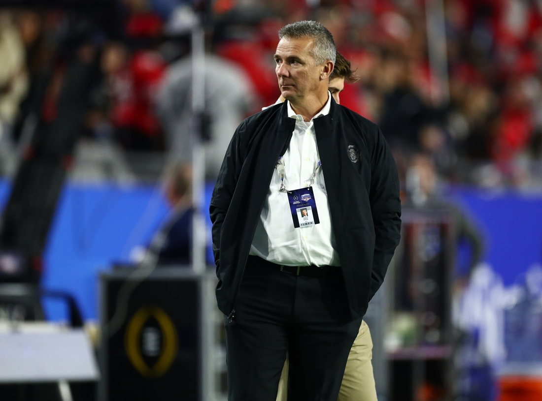 Dec 28, 2019; Glendale, Arizona, USA; Ohio State Buckeyes former head coach Urban Meyer on the field prior to the game against the Clemson Tigers in the 2019 Fiesta Bowl college football playoff semifinal game. Mandatory Credit: Matthew Emmons-USA TODAY Sports