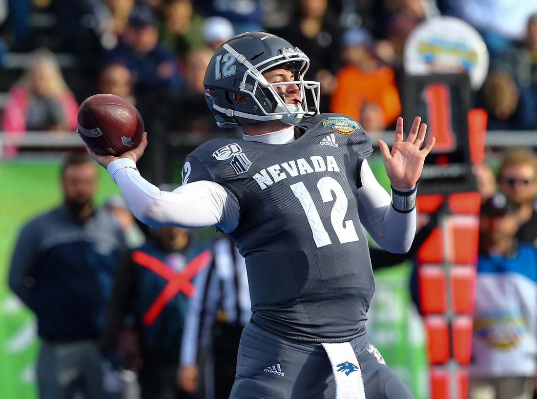 Jan 3, 2020; Boise, Idaho, USA; Nevada Wolf Pack quarterback Carson Strong (12) throws a pass during the first half of the Famous Idaho Potato Bowl against the Ohio Bobcats  at Albertsons Stadium. Mandatory Credit: Brian Losness-USA TODAY Sports