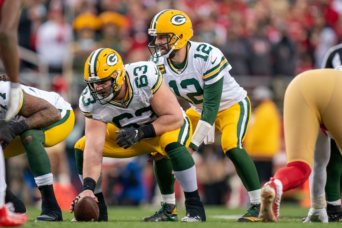 January 19, 2020; Santa Clara, California, USA; Green Bay Packers center Corey Linsley (63) and quarterback Aaron Rodgers (12) during the second quarter in the NFC Championship Game against the San Francisco 49ers at Levi's Stadium. Mandatory Credit: Kyle Terada-USA TODAY Sports