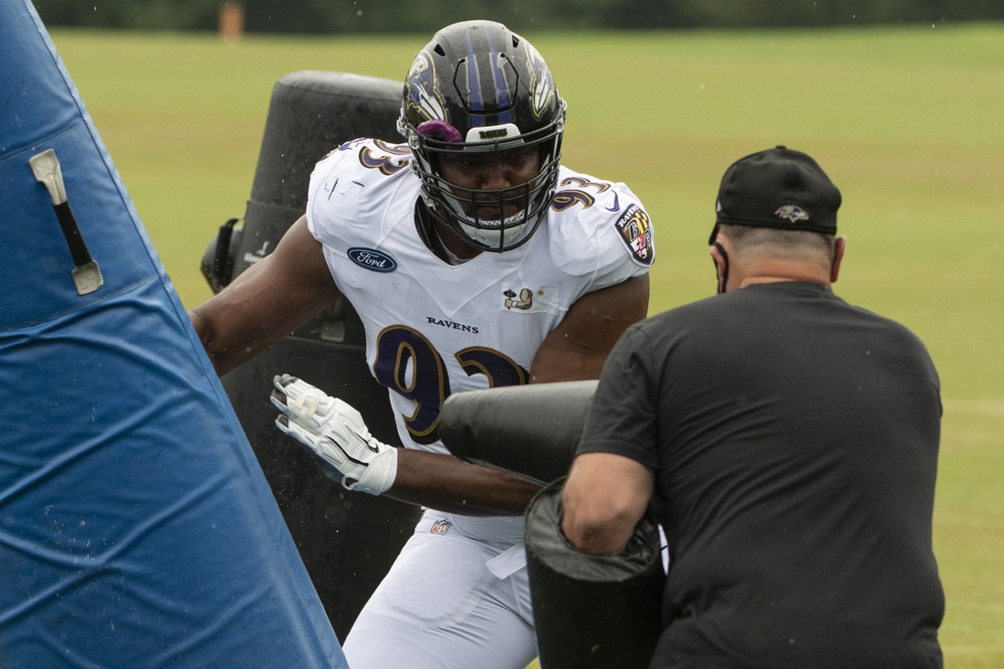 Aug 19, 2020; Owings Mills, Maryland, USA; Baltimore Ravens defensive end Calais Campbell (93) moves through defensive line coach Joe Cullen blocks during the morning session of training camp at Under Armour Performance Center. Mandatory Credit: Tommy Gilligan-USA TODAY Sports