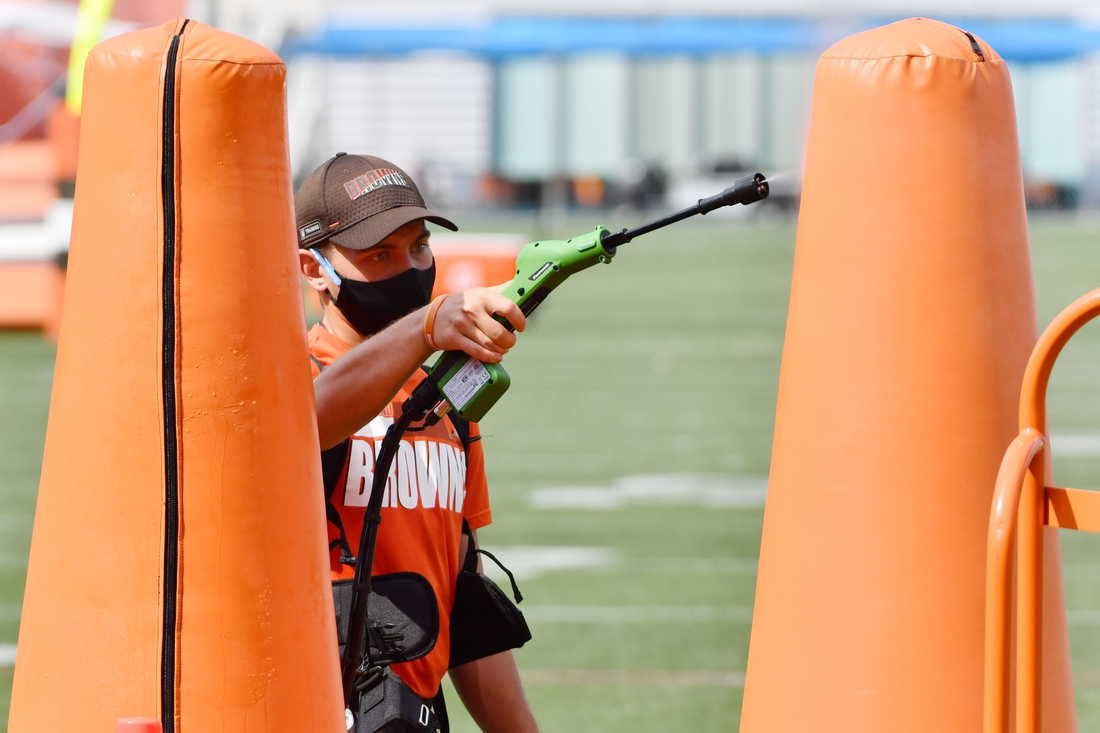 Aug 27, 2020; Berea, Ohio, USA; A Cleveland Browns employee disinfects equipment during training camp at the Cleveland Browns training facility. Mandatory Credit: Ken Blaze-USA TODAY Sports