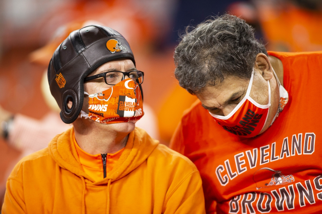 Sep 17, 2020; Cleveland, Ohio, USA;  Cleveland Browns fans talk while wearing their face masks for COVID-19 during the game against the Cincinnati Bengals at FirstEnergy Stadium. Mandatory Credit: Scott Galvin-USA TODAY Sports