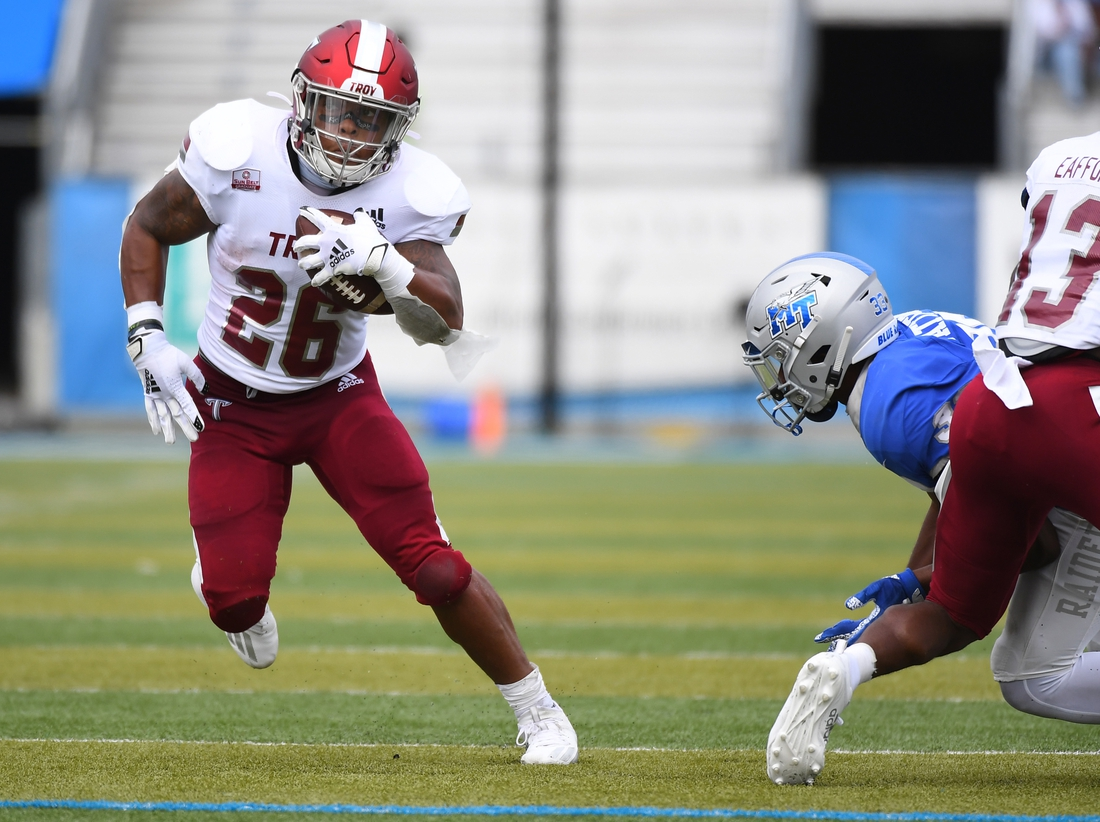 Sep 19, 2020; Murfreesboro, Tennessee, USA; Troy Trojans running back B.J. Smith (26) runs for a first down during the first half against the Middle Tennessee Blue Raiders at Floyd Stadium.  Mandatory Credit: Christopher Hanewinckel-USA TODAY Sports