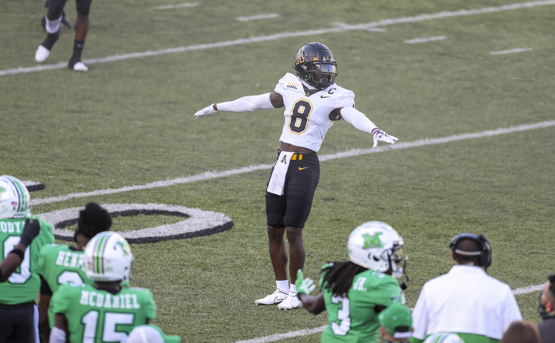 Appalachian State Mountaineers defensive back Shemar Jean-Charles (8) celebrates a broken up pass during the third quarter against the Marshall Thundering Herd at Joan C. Edwards Stadium. Mandatory Credit: Ben Queen-USA TODAY Sports