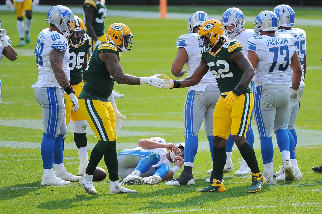Sep 20, 2020; Green Bay, Wisconsin, USA;  Green Bay Packers outside linebacker Preston Smith (91) and Green Bay Packers linebacker Rashan Gary (52) celebrate a sack made on Detroit Lions quarterback Matthew Stafford (9) in the fourth quarter at Lambeau Field. Final score Green Bay Packers 42, Detroit Lions 21. Mandatory Credit: Michael McLoone-USA TODAY Sports