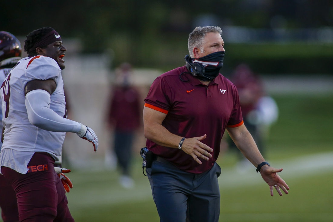 Oct 3, 2020; Durham, North Carolina, USA; Virginia Tech Hokies head coach Justin Fuente reacts as his team plays against the Duke Blue Devils in the second half at Wallace Wade Stadium. The Virginia Tech Hokies won 38-31. Mandatory Credit: Nell Redmond-USA TODAY Sports