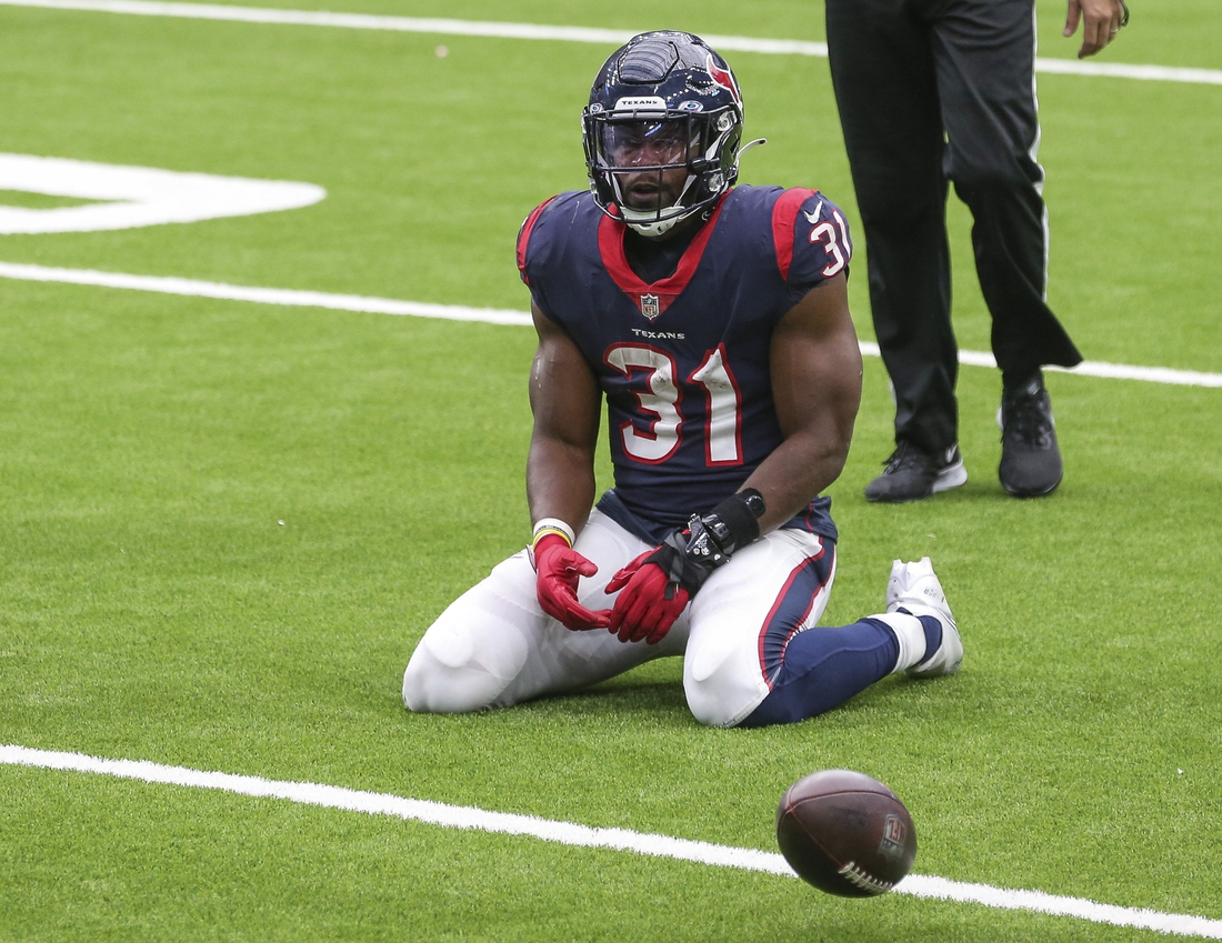 Oct 4, 2020; Houston, Texas, USA; Houston Texans running back David Johnson (31) reacts after fumbling the ball against the Minnesota Vikings on a play during the fourth quarter at NRG Stadium. Mandatory Credit: Troy Taormina-USA TODAY Sports