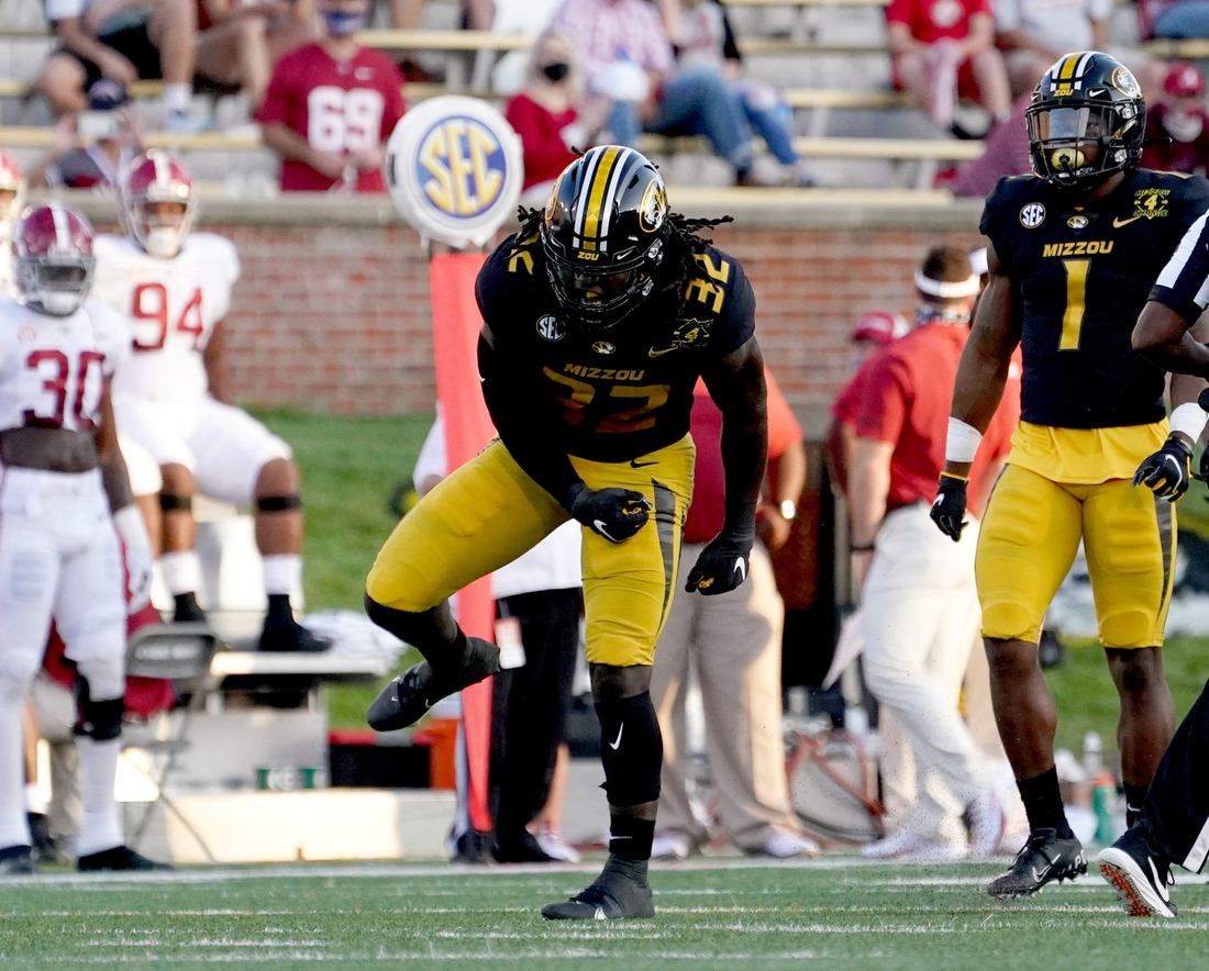 Sep 26, 2020; Columbia, Missouri, USA; Missouri Tigers linebacker Nick Bolton (32) celebrates after a tackle during the game against the Alabama Crimson Tide at Faurot Field at Memorial Stadium. Mandatory Credit: Denny Medley-USA TODAY Sports