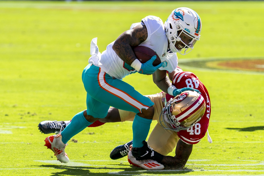 October 11, 2020; Santa Clara, California, USA; Miami Dolphins running back Myles Gaskin (37) is tackled by San Francisco 49ers cornerback Brian Allen (48) during the first quarter at Levi's Stadium. Mandatory Credit: Kyle Terada-USA TODAY Sports