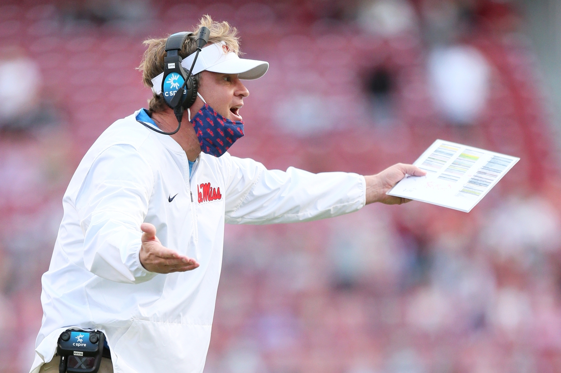 Oct 17, 2020; Fayetteville, Arkansas, USA; Ole Miss Rebels  head coach Lane Kiffin reacts to a call during the fourth quarter against the Arkansas Razorbacks at Donald W. Reynolds Razorback Stadium. Arkansa won 33-21. Mandatory Credit: Nelson Chenault-USA TODAY Sports