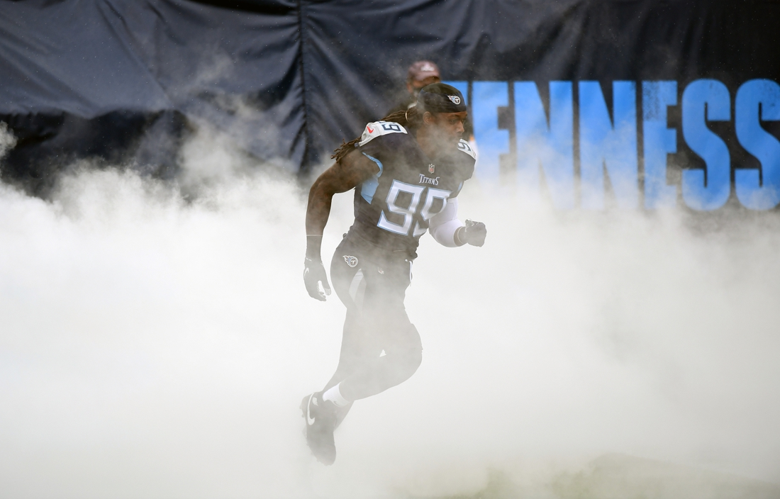 Oct 18, 2020; Nashville, Tennessee, USA; Tennessee Titans outside linebacker Jadeveon Clowney (99) takes the field during player introductions before a game against the Houston Texans at Nissan Stadium. Mandatory Credit: Christopher Hanewinckel-USA TODAY Sports