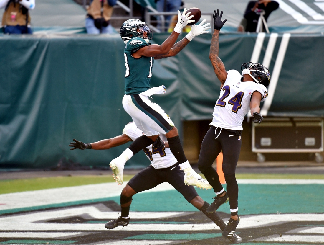 Oct 18, 2020; Philadelphia, Pennsylvania, USA; Philadelphia Eagles wide receiver Travis Fulgham (13) catches an 18-yard touchdown pass against Baltimore Ravens cornerback Marlon Humphrey (44) and cornerback Marcus Peters (24) during the fourth quarter at Lincoln Financial Field. Mandatory Credit: Eric Hartline-USA TODAY Sports