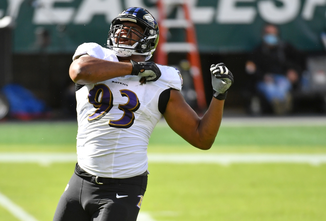 Oct 18, 2020; Philadelphia, Pennsylvania, USA; Baltimore Ravens defensive end Calais Campbell (93) celebrates after a sack against the Philadelphia Eagles during the first quarter at Lincoln Financial Field. Mandatory Credit: Eric Hartline-USA TODAY Sports