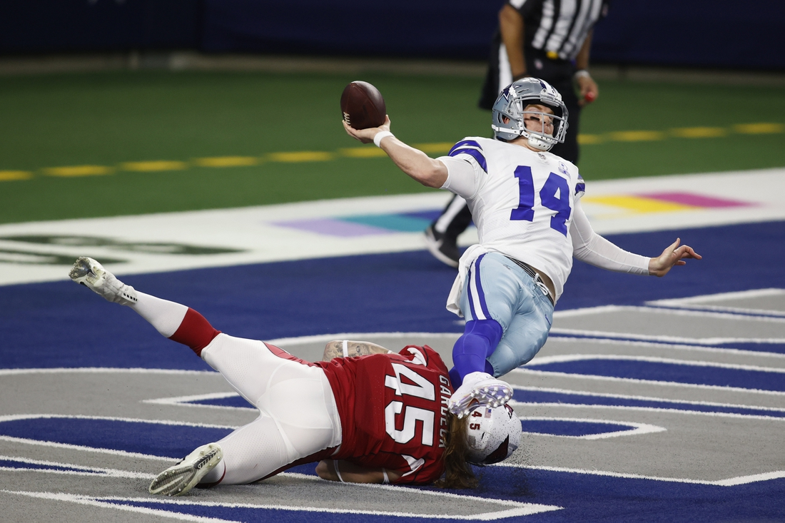 Oct 19, 2020; Arlington, Texas, USA; Arizona Cardinals linebacker Dennis Gardeck (45) tries to tackle Dallas Cowboys quarterback Andy Dalton (14) in the end zone in the first quarter at AT&T Stadium. Mandatory Credit: Tim Heitman-USA TODAY Sports