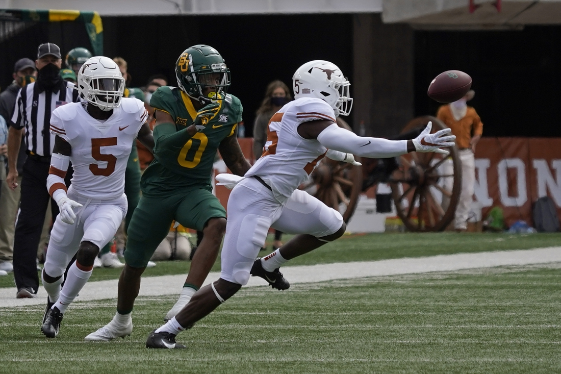 Oct 24, 2020; Austin, Texas, USA; Texas Longhorns defensive back Chris Brown (15) breaks up a pass intended for Baylor Bears wide receiver R.J. Sneed (00) in the first quarter at Darrell K Royal-Texas Memorial Stadium. Mandatory Credit: Scott Wachter-USA TODAY Sports