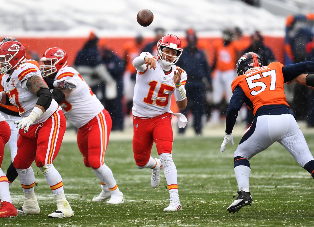Oct 25, 2020; Denver, Colorado, USA; Kansas City Chiefs quarterback Patrick Mahomes (15) passes the ball in the first half against the Denver Broncos at Empower Field at Mile High. Mandatory Credit: Ron Chenoy-USA TODAY Sports