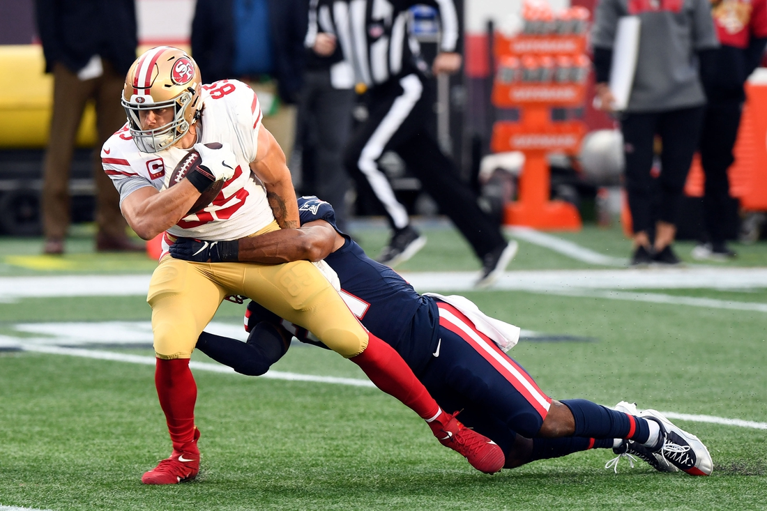 Oct 25, 2020; Foxborough, Massachusetts, USA; San Francisco 49ers tight end George Kittle (85) is tackled by New England Patriots strong safety Adrian Phillips (21) during the first half at Gillette Stadium. Mandatory Credit: Brian Fluharty-USA TODAY Sports