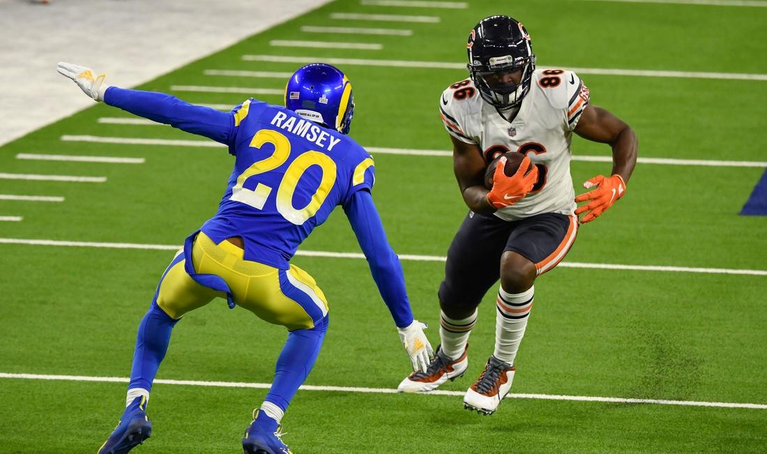 Oct 26, 2020; Inglewood, California, USA; Chicago Bears tight end Demetrius Harris (86) tries to run past Los Angeles Rams cornerback Jalen Ramsey (20) during the third quarter at SoFi Stadium. Mandatory Credit: Robert Hanashiro-USA TODAY Sports