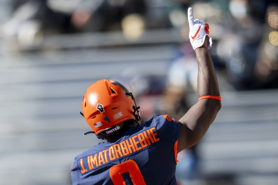 Oct 31, 2020; Champaign, Illinois, USA; Illinois Fighting Illini wide receiver Josh Imatorbhebhe (9) celebrates running back Mike Epstein   s touchdown during the first half against the Purdue Boilermakers at Memorial Stadium. Mandatory Credit: Patrick Gorski-USA TODAY Sports