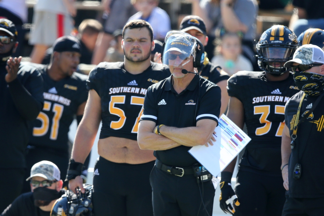 Oct 31, 2020; Hattiesburg, Mississippi, USA; Southern Miss Golden Eagles interim head coach Tim Billings, wearing shield, against the Rice Owls in the first quarter at M.M. Roberts Stadium. Mandatory Credit: Chuck Cook-USA TODAY Sports
