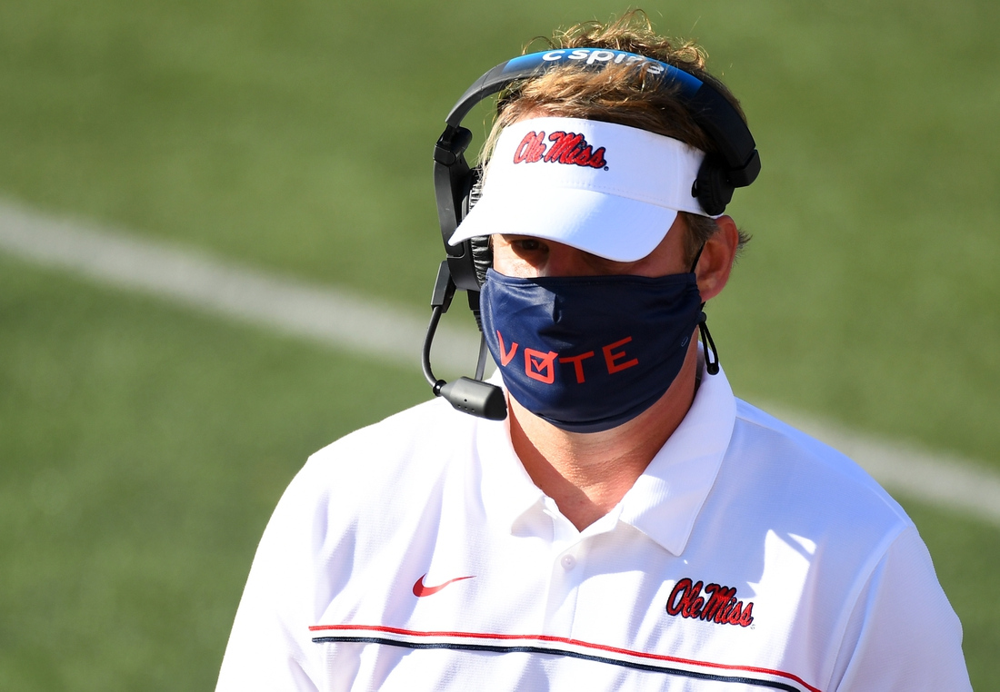 Oct 31, 2020; Nashville, Tennessee, USA; Mississippi Rebels head coach Lane Kiffin wears a mask with the word vote printed on the front during the first half against the Vanderbilt Commodores at Vanderbilt Stadium. Mandatory Credit: Christopher Hanewinckel-USA TODAY Sports