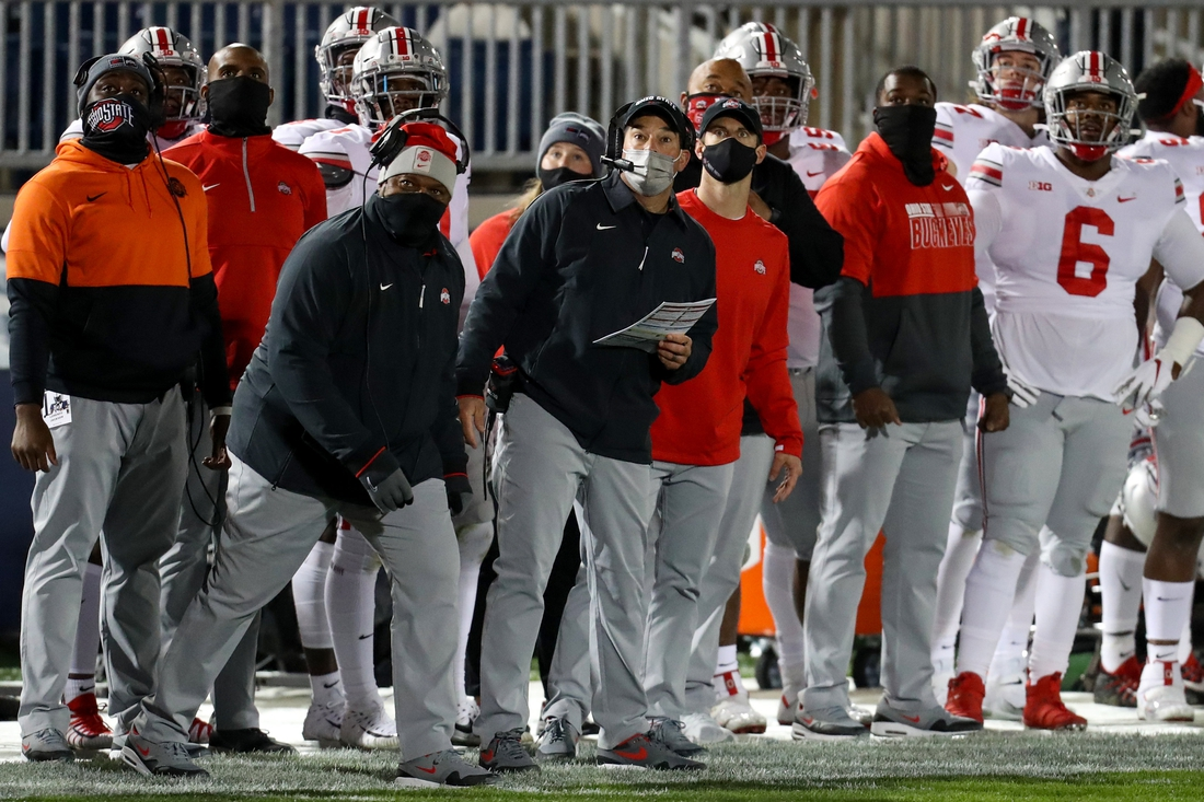 Oct 31, 2020; University Park, Pennsylvania, USA; Ohio State Buckeyes head coach Ryan Day (center) looks on during the first quarter against the Penn State Nittany Lions at Beaver Stadium. Mandatory Credit: Matthew OHaren-USA TODAY Sports