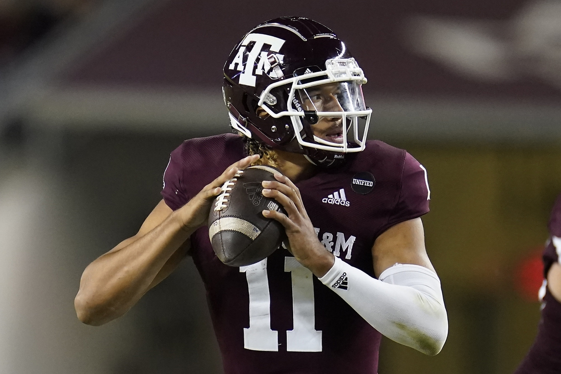 Oct 31, 2020; College Station, TX, USA; Texas A&M quarterback Kellen Mond (11) looks down field to pass against Arkansas during the second half of an NCAA college football game, Saturday, Oct. 31, 2020, in College Station, Texas. Mandatory Credit: Sam Craft/Pool Photo-USA TODAY Sports