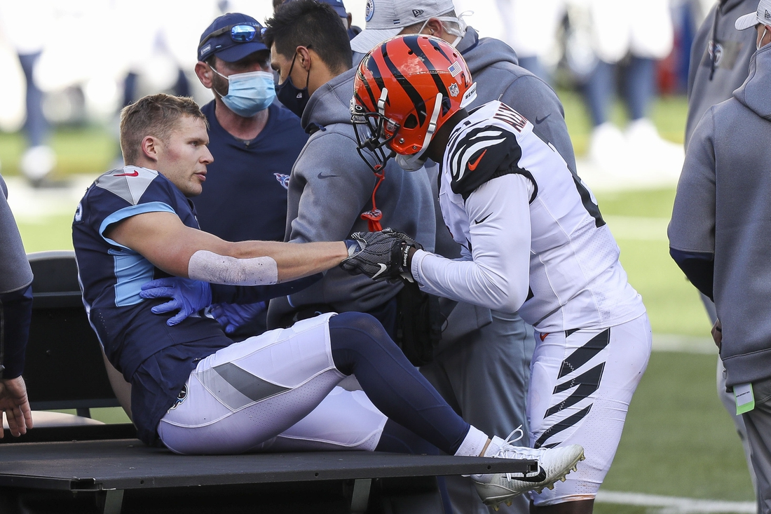 Nov 1, 2020; Cincinnati, Ohio, USA; Tennessee Titans wide receiver Adam Humphries (10) shakes hands with Cincinnati Bengals cornerback Mackensie Alexander (21) before being carted off the field after suffering an apparent injury in the first half at Paul Brown Stadium. Mandatory Credit: Katie Stratman-USA TODAY Sports
