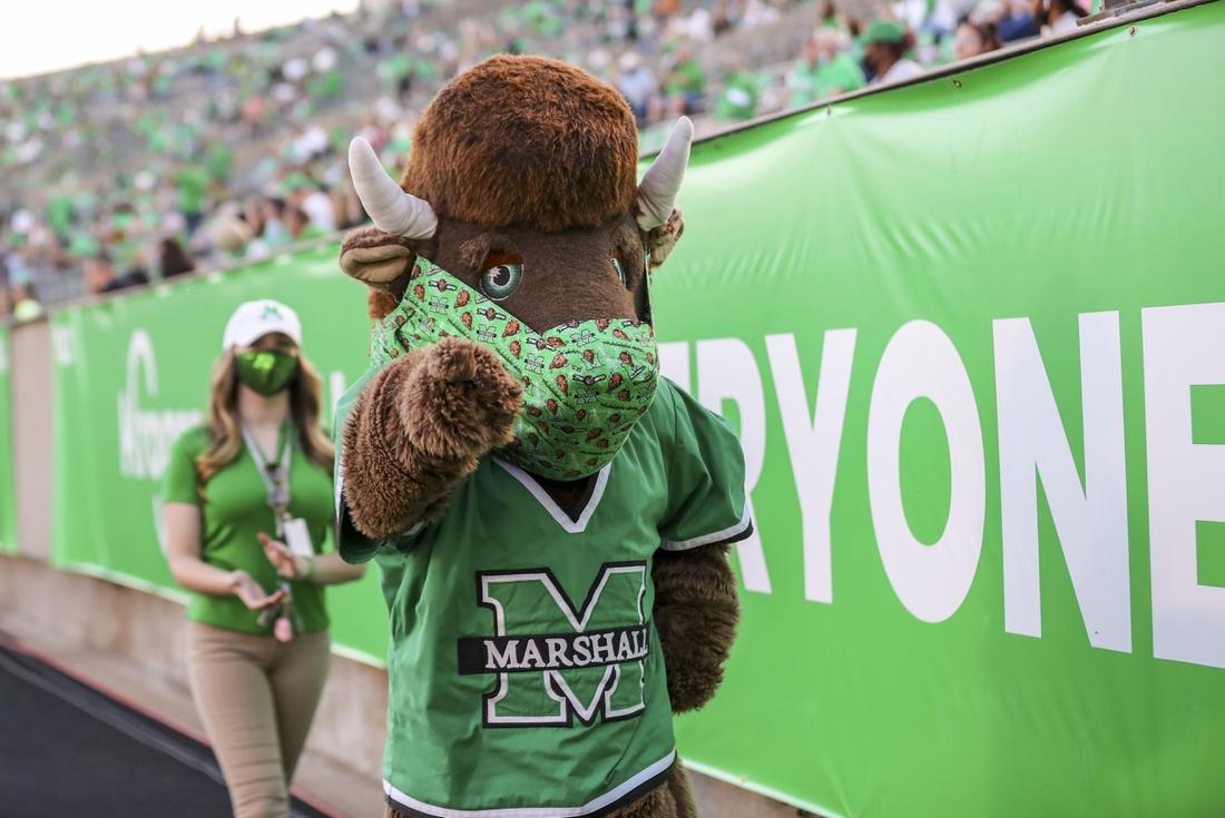 Nov 7, 2020; Huntington, West Virginia, USA; The Marshall Thundering Herd mascot celebrates during the fourth quarter against the Massachusetts Minutemen at Joan C. Edwards Stadium. Mandatory Credit: Ben Queen-USA TODAY Sports