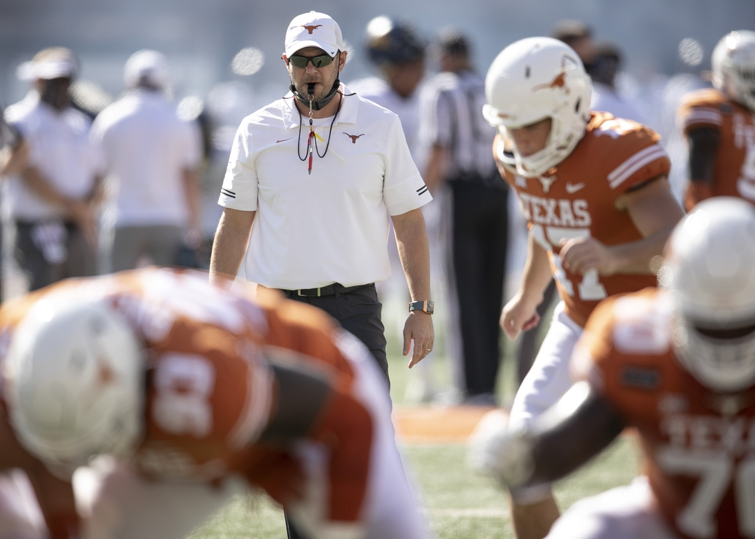Nov 7, 2020; Austin, Texas, USA;  Texas head coach Tom Herman leads his team during warmups before the game against West Virginia at Royal-Memorial Stadium on Saturday November 7, 2020.  Mandatory Credit: Jay Janner-USA TODAY NETWORK