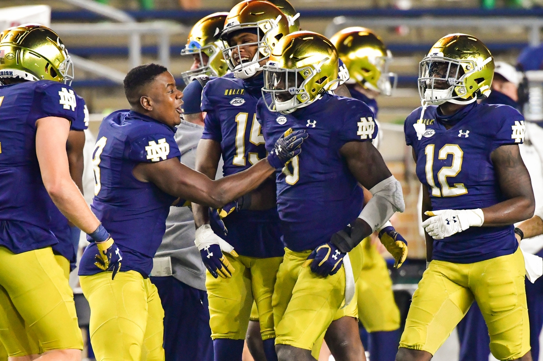 Nov 7, 2020; South Bend, Indiana, USA; Notre Dame Fighting Irish linebacker Jeremiah Owusu-Koramoah (6) celebrates after a touchdown in the second quarter against the Clemson Tigers at Notre Dame Stadium. Mandatory Credit: Matt Cashore-USA TODAY Sports