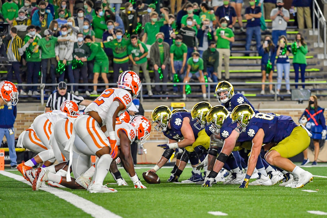 Nov 7, 2020; South Bend, Indiana, USA; Notre Dame Fighting Irish quarterback Ian Book (12) readies for the snap in the first quarter against the Clemson Tigers at Notre Dame Stadium. Notre Dame defeated Clemson 47-40 in two overtimes. Mandatory Credit: Matt Cashore-USA TODAY Sports