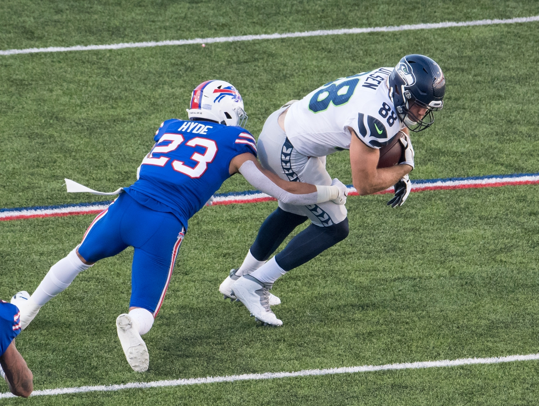 Nov 8, 2020; Orchard Park, New York, USA; Seattle Seahawks tight end Greg Olsen (88) is tackled by Buffalo Bills strong safety Micah Hyde (23) after making a catch in the third quarter at Bills Stadium. Mandatory Credit: Mark Konezny-USA TODAY Sports