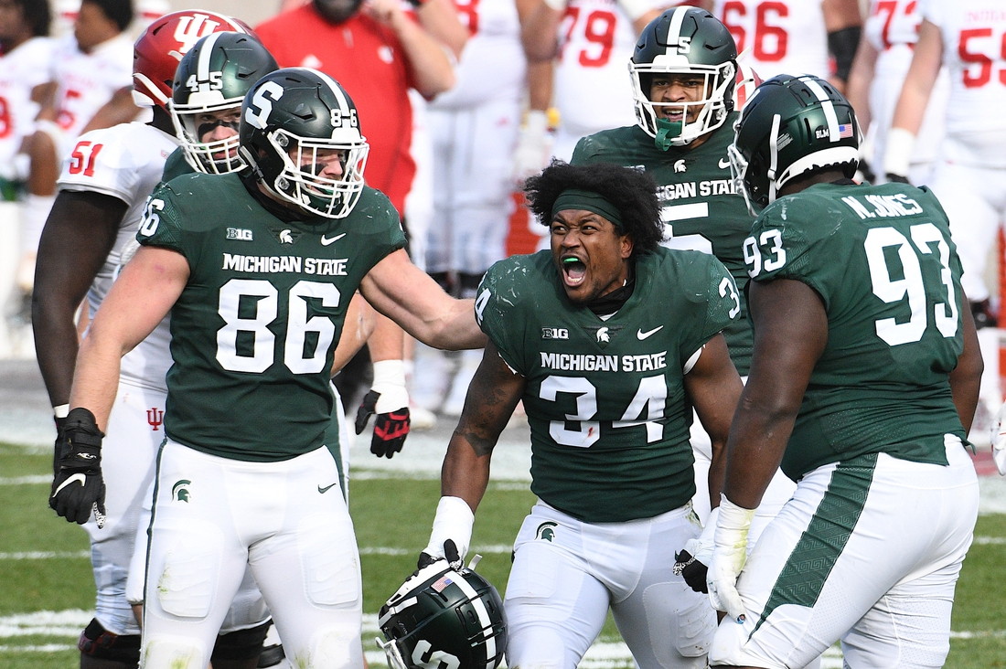 Nov 14, 2020; East Lansing, Michigan, USA; Michigan State Spartans linebacker Antjuan Simmons (34) celebrates after a play during the second quarter against the Indiana Hoosiers at Spartan Stadium. Mandatory Credit: Tim Fuller-USA TODAY Sports