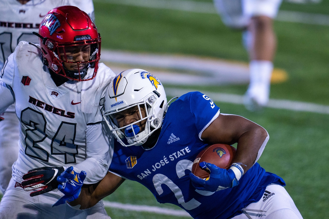 Nov 14, 2020; San Jose, California, USA; San Jose State Spartans running back Tyler Nevens (23) is tackled by UNLV Rebels defensive back Bryce Jackson (24) during the fourth quarter at CEFCU Stadium. Mandatory Credit: Neville E. Guard-USA TODAY Sports