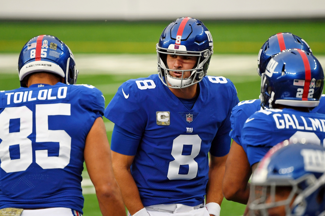 Nov 15, 2020; East Rutherford, New Jersey, USA; New York Giants quarterback Daniel Jones (8) huddles with the team during warmups before the game against the Philadelphia Eagles at MetLife Stadium. Mandatory Credit: Robert Deutsch-USA TODAY Sports
