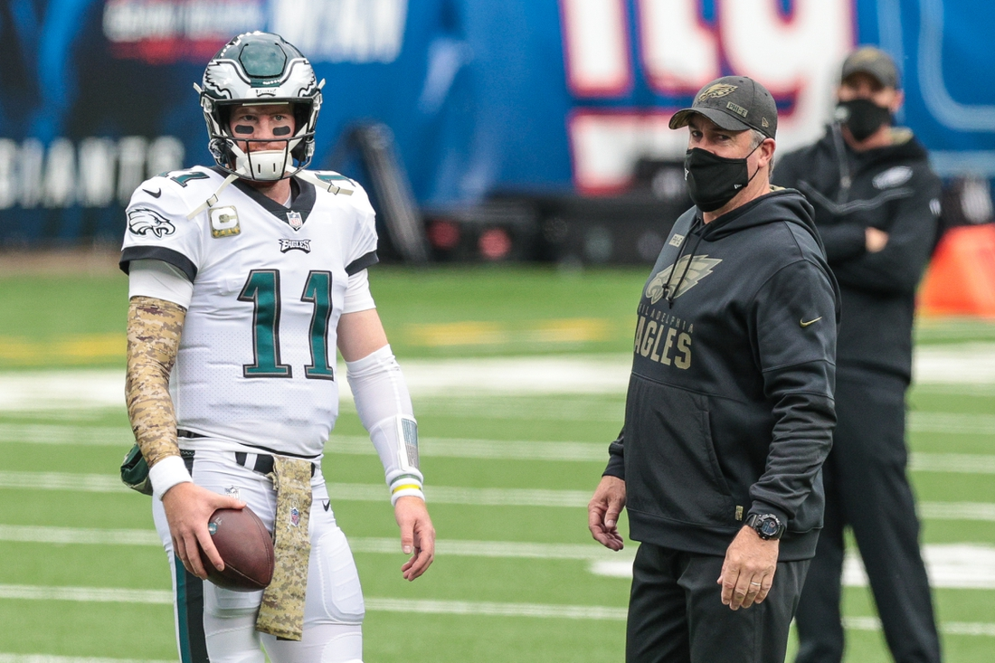 Nov 14, 2020; Piscataway, New Jersey, USA;  Philadelphia Eagles head coach Doug Pederson talks with quarterback Carson Wentz (11) during warm ups before their game against the New York Giants at Met Life Stadium. Mandatory Credit: Vincent Carchietta-USA TODAY Sports