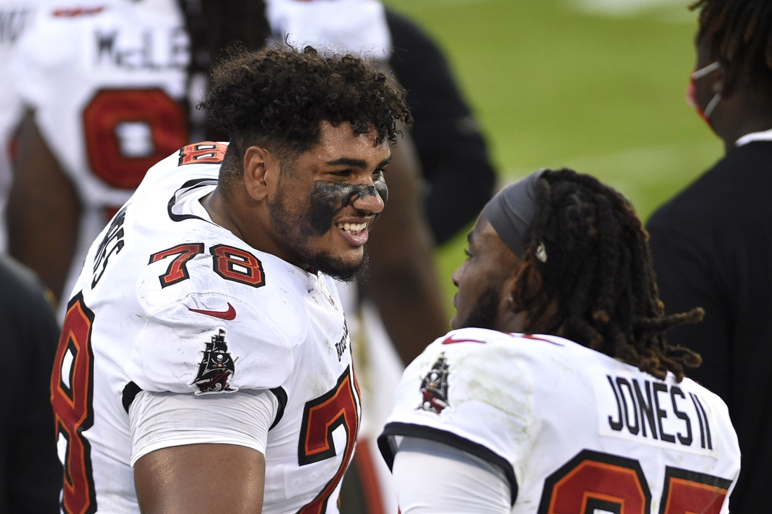 Nov 15, 2020; Charlotte, North Carolina, USA; Tampa Bay Buccaneers offensive tackle Tristan Wirfs (78) talks to running back Ronald Jones (27) on the sidelines in the third quarter at Bank of America Stadium. Mandatory Credit: Bob Donnan-USA TODAY Sports