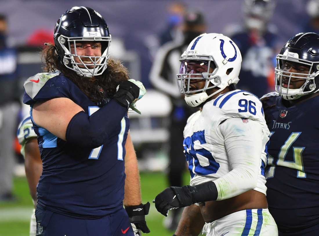 Nov 12, 2020; Nashville, Tennessee, USA; Tennessee Titans offensive tackle Dennis Kelly (71) and Indianapolis Colts defensive end Denico Autry (96) exchange words after a play during the second half at Nissan Stadium. Mandatory Credit: Christopher Hanewinckel-USA TODAY Sports