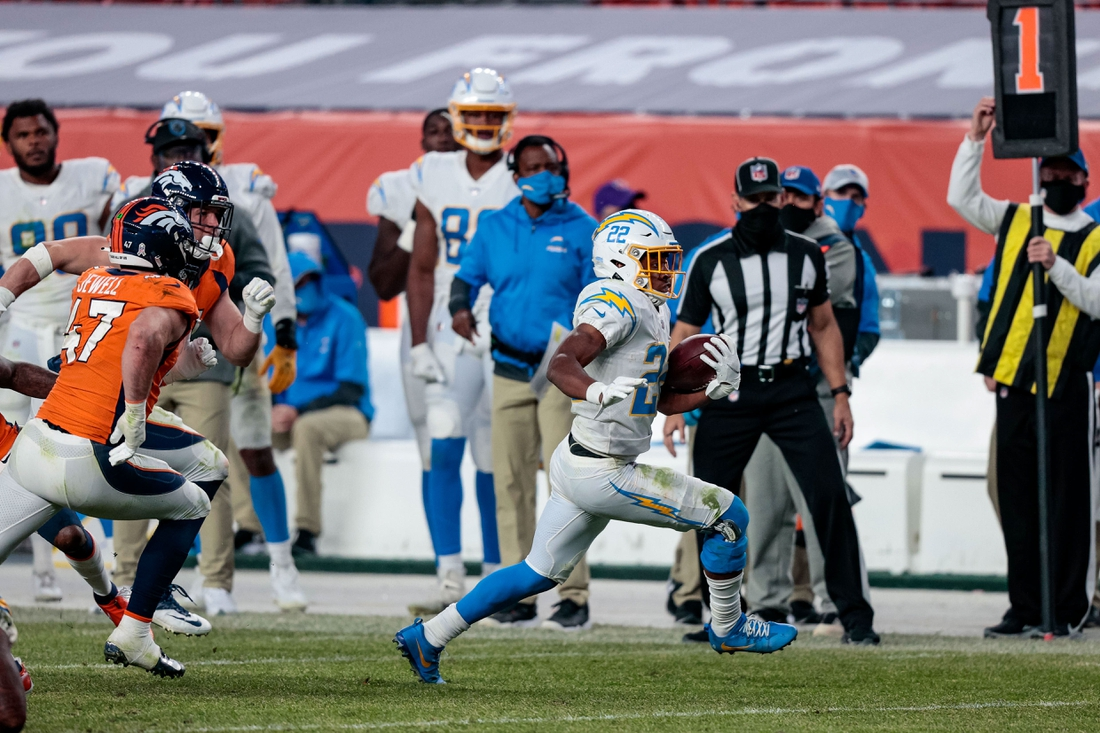 Nov 1, 2020; Denver, Colorado, USA; Los Angeles Chargers running back Justin Jackson (22) runs the ball in the fourth quarter against the Denver Broncos at Empower Field at Mile High. Mandatory Credit: Isaiah J. Downing-USA TODAY Sports