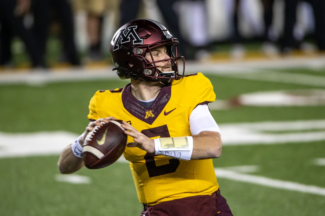 Nov 20, 2020; Minneapolis, Minnesota, USA; Minnesota Golden Gophers quarterback Tanner Morgan (2) drops back for a pass in the first half against the Purdue Boilermakers at TCF Bank Stadium. Mandatory Credit: Jesse Johnson-USA TODAY Sports