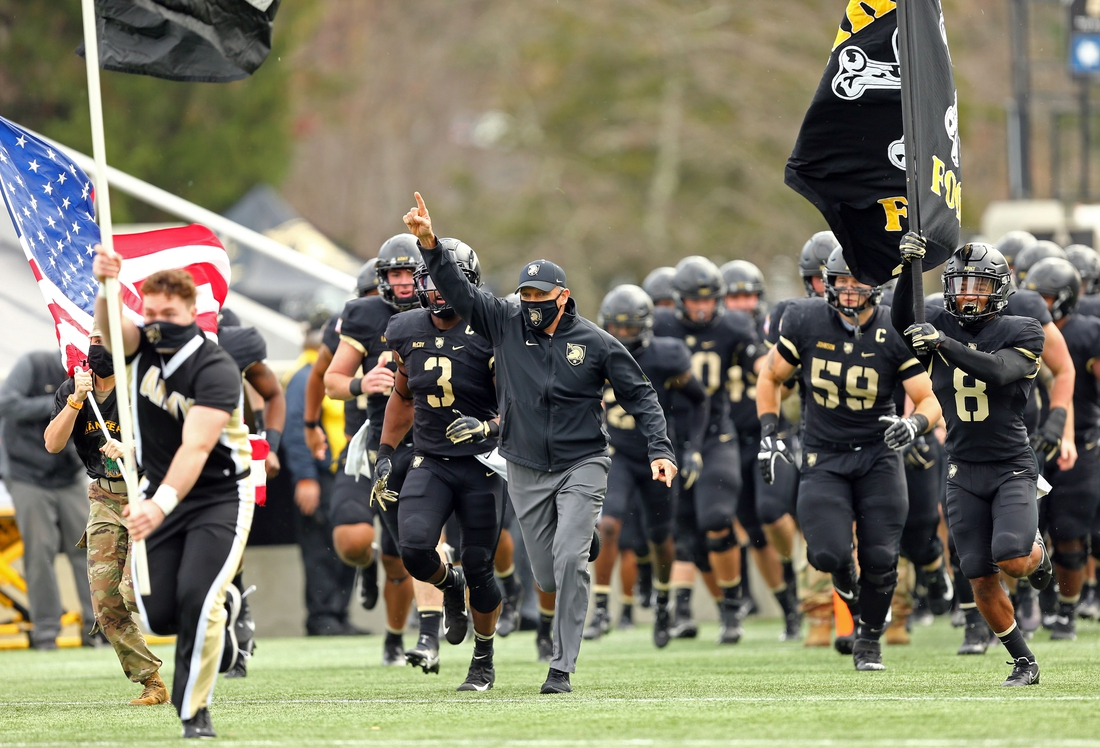 Nov 21, 2020; West Point, New York, USA; Army Black Knights head coach Jeff Monken leads his team out to the field before a game against the Georgia Southern Eagles at Michie Stadium. Mandatory Credit: Danny Wild-USA TODAY Sports