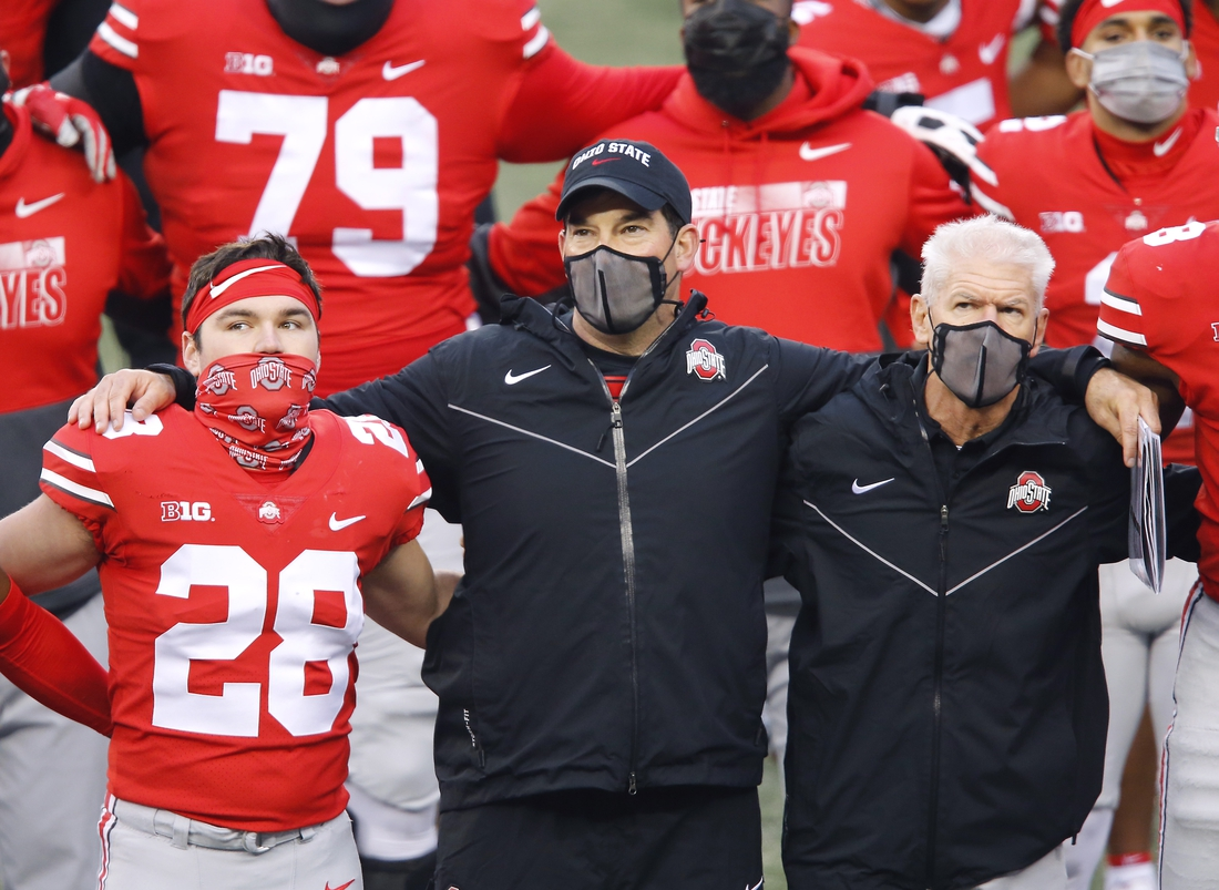Nov 21, 2020; Columbus, Ohio, USA; Ohio State Buckeyes head coach Ryan Day (center) and defensive coordinator Kerry Coombs(right) and place kicker Dominic DiMaccio (28)after the game against the Indiana Hoosiers at Ohio Stadium. Mandatory Credit: Joseph Maiorana-USA TODAY Sports
