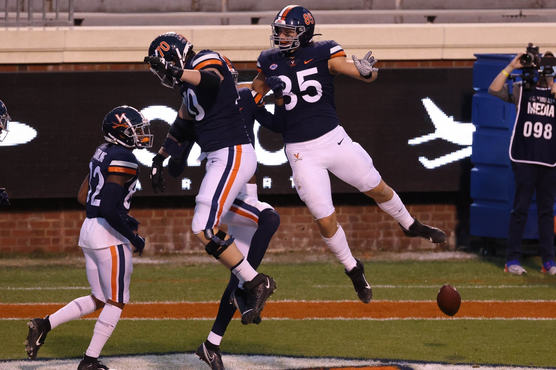 Nov 21, 2020; Charlottesville, Virginia, USA; Virginia Cavaliers wide receiver Lavel Davis Jr. (81) celebrates with Cavaliers offensive tackle Bobby Haskins (70) and Cavaliers tight end Grant Misch (85) after scoring a touchdown against the Abilene Christian Wildcats in the first quarter at Scott Stadium. Mandatory Credit: Geoff Burke-USA TODAY Sports
