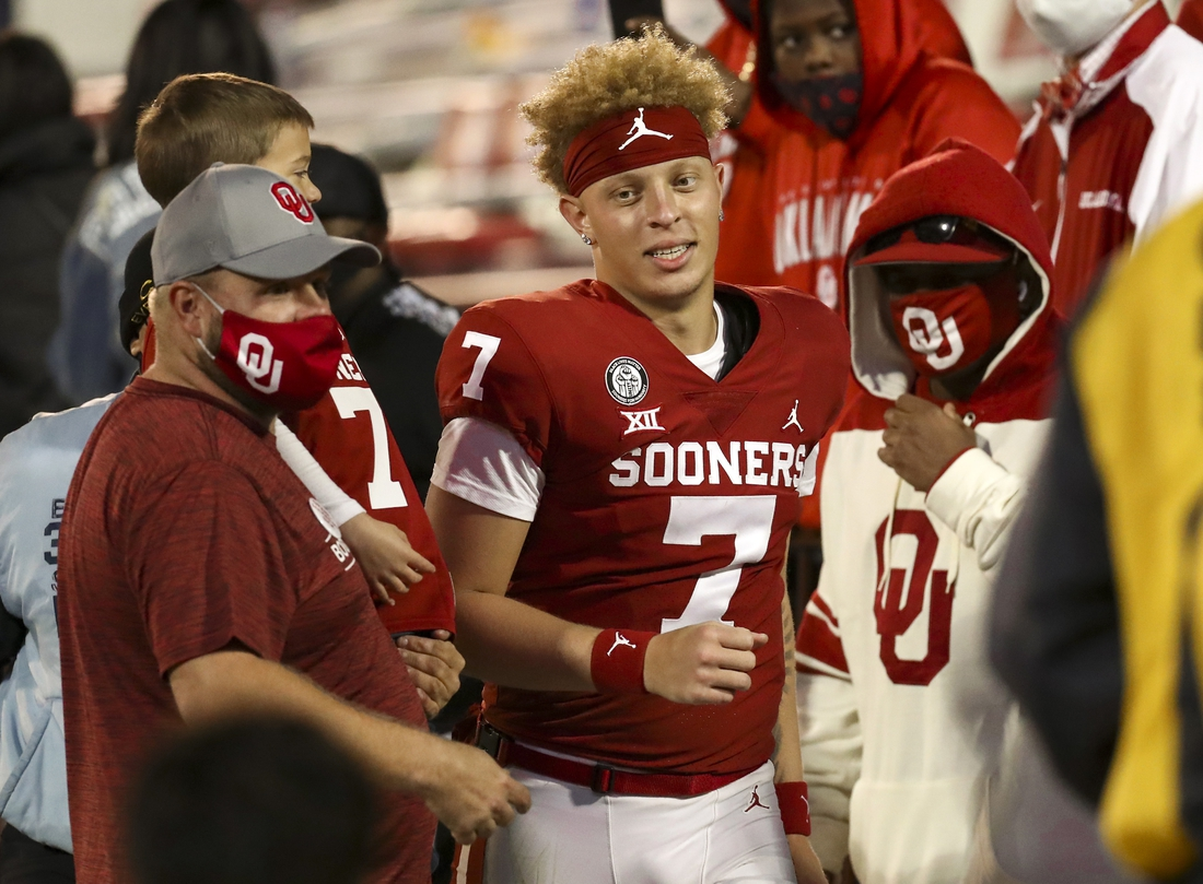 Nov 21, 2020; Norman, Oklahoma, USA;  Oklahoma Sooners quarterback Spencer Rattler (7) with fans after the game against the Oklahoma State Cowboys at Gaylord Family-Oklahoma Memorial Stadium. Mandatory Credit: Kevin Jairaj-USA TODAY Sports