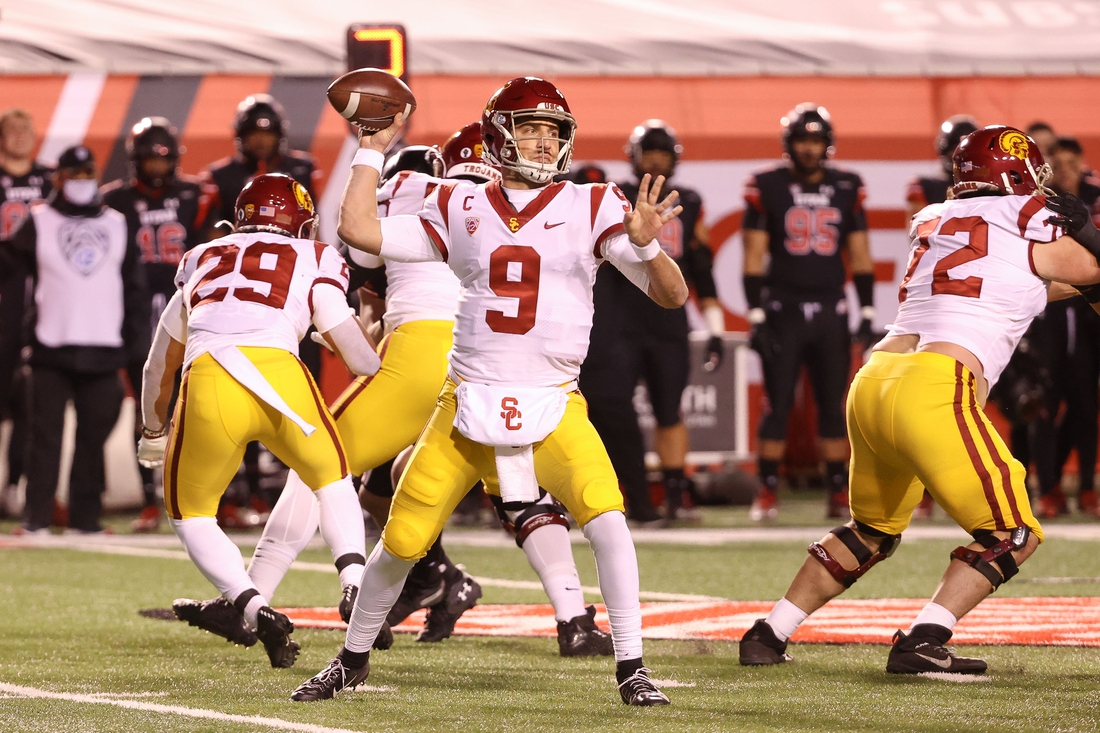 Nov 21, 2020; Salt Lake City, Utah, USA; USC Trojans quarterback Kedon Slovis (9) throws the ball during the second quarter against the Utah Utes at Rice-Eccles Stadium. Mandatory Credit: Chris Nicoll-USA TODAY Sports