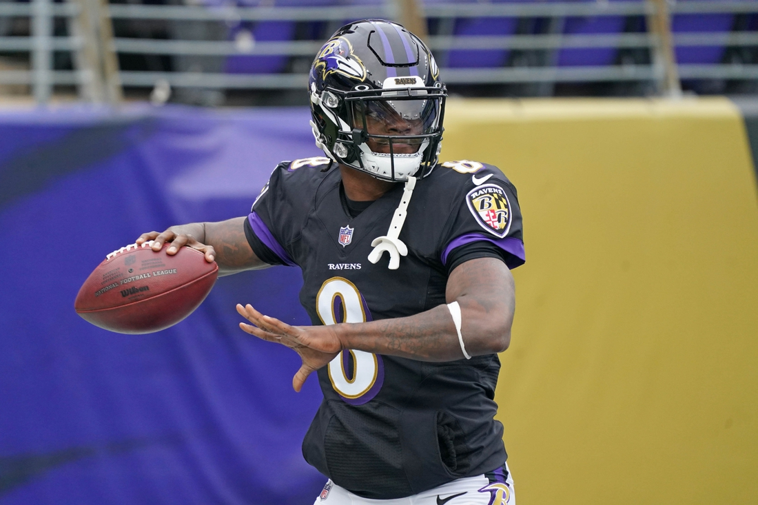 Nov 22, 2020; Baltimore, Maryland, USA; Baltimore Ravens  quarterback Lamar Jackson (8) warms up prior to the game against the Tennessee Titans at M&T Bank Stadium. Mandatory Credit: Mitch Stringer-USA TODAY Sports