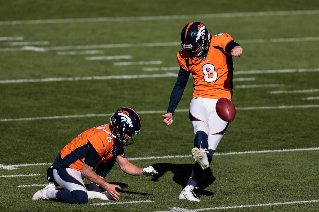 Nov 22, 2020; Denver, Colorado, USA; Denver Broncos kicker Brandon McManus (8) practices field goals as punter Sam Martin (6) holds the ball before the game against the Miami Dolphins at Empower Field at Mile High. Mandatory Credit: Isaiah J. Downing-USA TODAY Sports