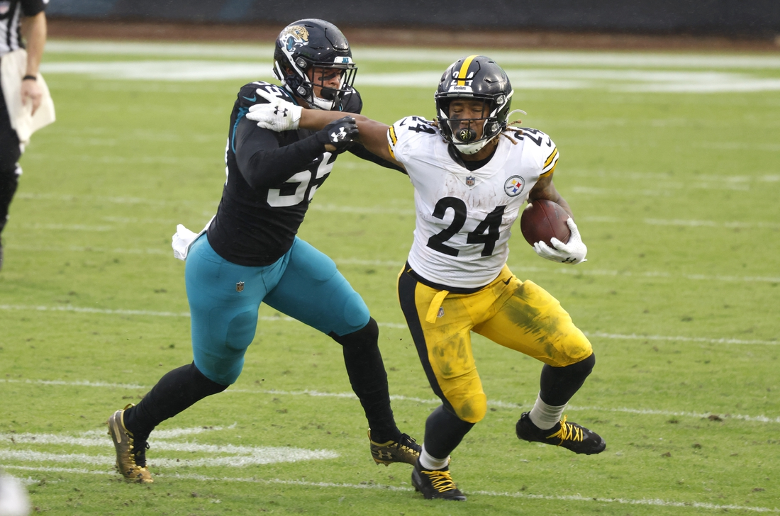 Nov 22, 2020; Jacksonville, Florida, USA;  Jacksonville Jaguars outside linebacker Kamalei Correa (55) chases Pittsburgh Steelers running back Benny Snell (24) during the second half at TIAA Bank Field. Mandatory Credit: Reinhold Matay-USA TODAY Sports